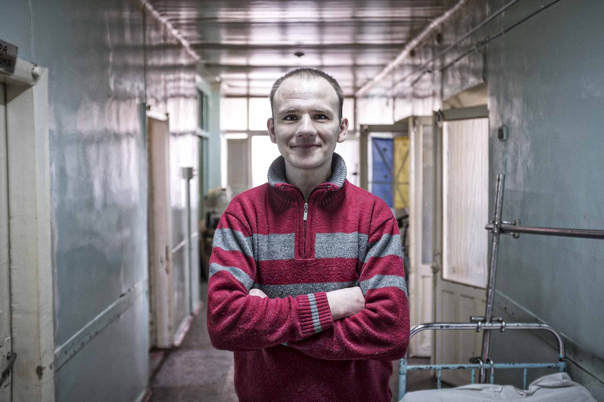Andrey, volunteer, 29, helps wounded soldiers at the hospital. He has a gentle smile that may be reflects is belonging to the Hram Slavy Hospoda Evangelist. Bakhmout - UKRAINE