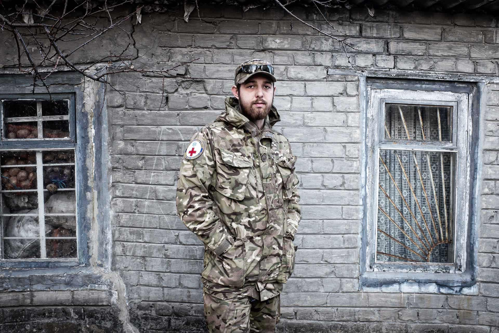 Bogdan, 20, volunteering as a soldier and aspires to enter the medical unit of military hospital. His sad look reflects the hard times he experienced in Debaltsevo a few days ago. Bakhmout - UKRAINE